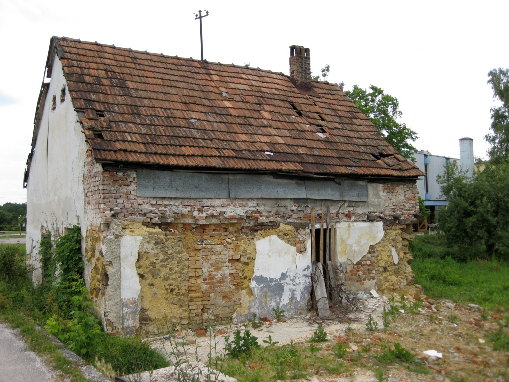 A small building with bomb shrapnel damage in Gvozd